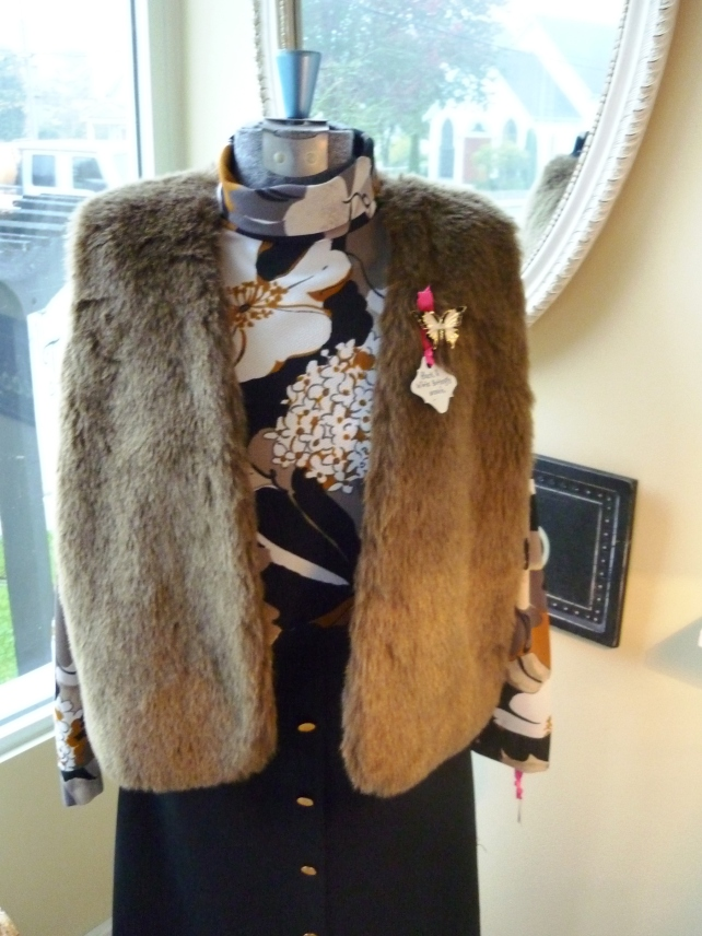 Et voila: outift!  Fur vests are so chic with anything from dresses to skinny jeans, and everything in between!  This brown one is super soft and simple.