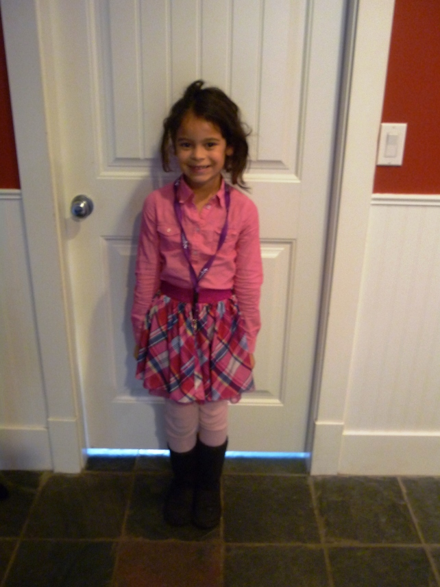 How cute is she?!?  She combined different shades of pink and added her brown uggs for comfort.  I think they're great contrast, too!