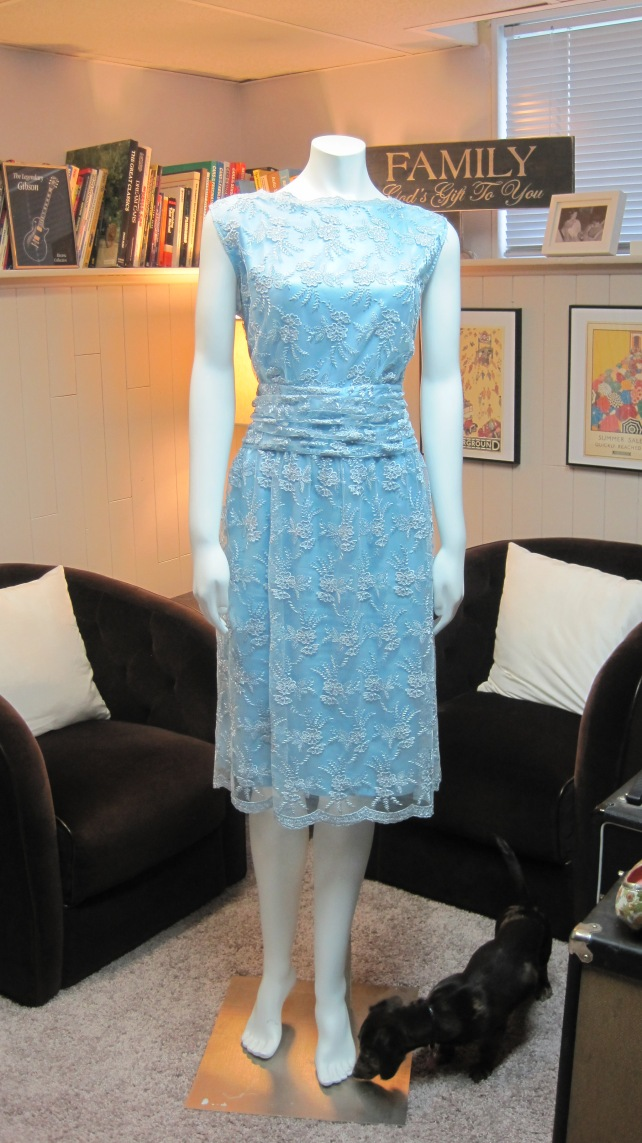 I had my seamstress shorten the dress, but keep the scalloped hem.  She also took off the sleeves.