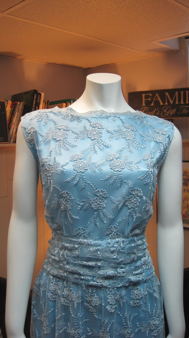 Close up of the scalloped neckline and ruched waist, both remain unchanged after alterations.