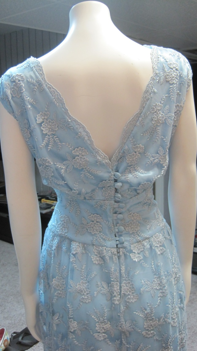 Scalloped v-back and covered buttons