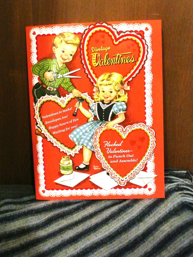 I found this at London Drugs the other night: it's an old fashioned punch-out valentines day card book!  I remember giving these to my classmates in elementary school.