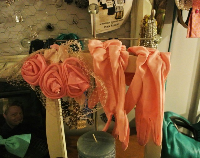 Some vintage pink gloves and a fascinator on my dressing table.
