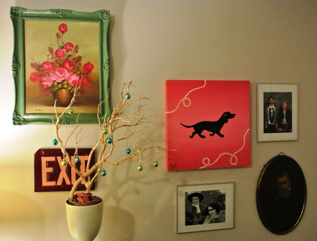 Wall art.  The pink dachshund painting is by my talented cousin, Lauren.