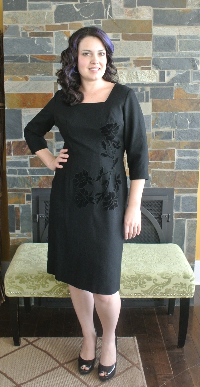 This black 60s wiggle dress is a beautiful lined wool with velvet flowers on the bodice.