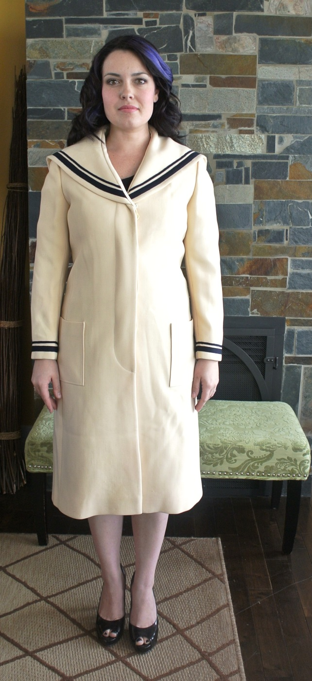 This is an amazing find!  Just under knee-length cream sailor coat with navy trim at the collar and wrists.  The coat is solidly constructed, 60s does 20s.