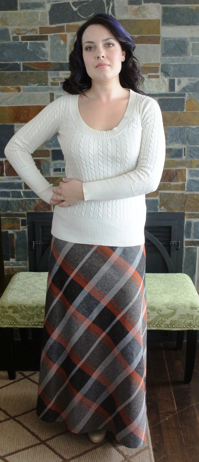 And finally, I found this wonderful plaid maxi skirt recently and you know, I can never resist a plaid maxi.  Or mini.  Or plaid anything, really.  This is a really easy piece to throw on with a cream sweater like Corine did here.  Don't you just love it?