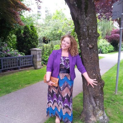 PS-Here's how I wore the dress a couple of years ago to the screening of MisRepresentation: With a navy obi belt, purple blazer and sandals.  And blonde hair!!!