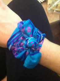 A vintage scarf makes for great wrist candy.