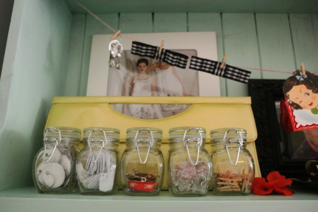 The tiny jars hold my tiny things, like baby clothespins, price labels, safety pins and tacks.