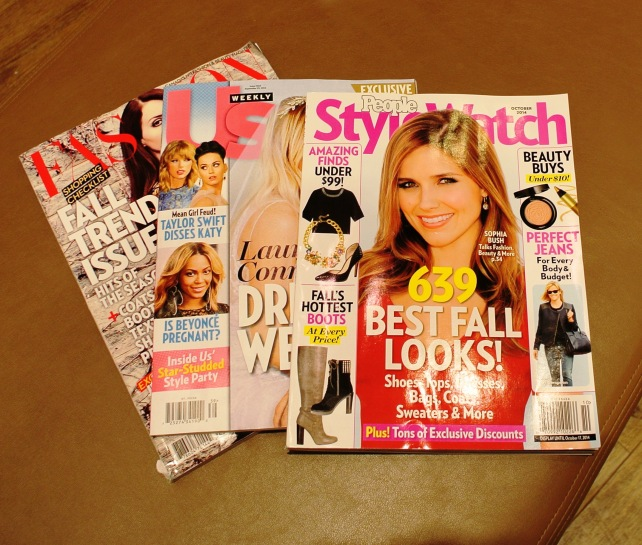 I don't buy trashy magazines (like US), but I do read them at Chapters sometimes.  Guilty pleasure.