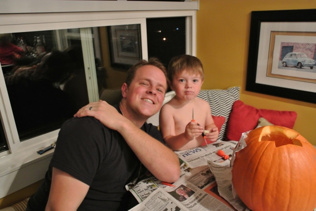 Daddy and little HoHo carve his very first pumpkin, it turned out great!