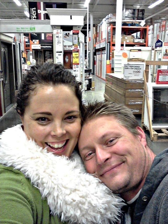 We have a cozy moment in the home depot, and Jeff actually fits his top part in the frame.  My scarf doubles as a blanky-pillow.