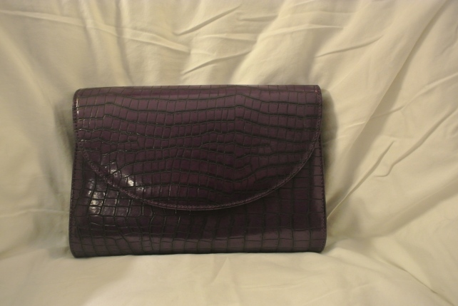 Purple mock croc clutch.