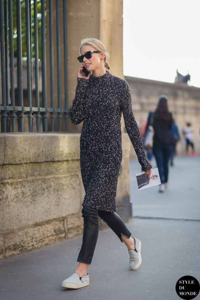 Casual: Sweater dress over vegan leather pants and sneakers