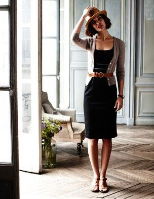 Thicker brow leather belt around a dress and cardigan.