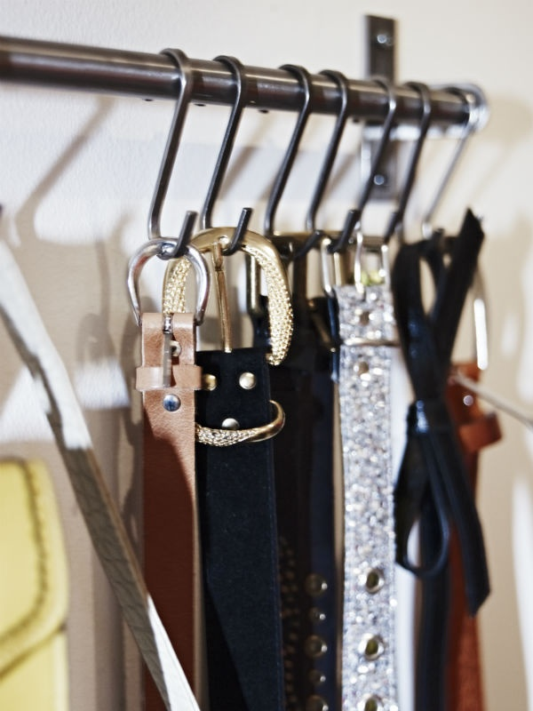 BELTS, because I featured them yesterday.  Use a curtain rod and s-shaped hooks to keep your belts handy and visible in your closet or bedroom.