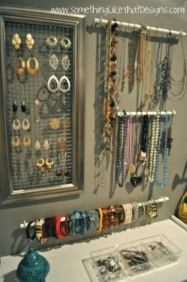I love this idea for earrings so much I have my own!  Use a big frame and chicken wire to make this display.  The bars on the wall are kitchen utensil bars that you can buy at IKEA.