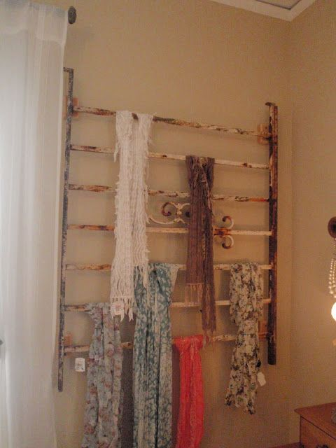 Great idea for storing and displaying scarves: use an old iron headoard