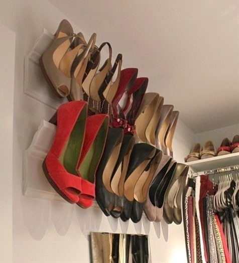 I love this idea for shoes: use crown moulding!  Perfect for small spaces.