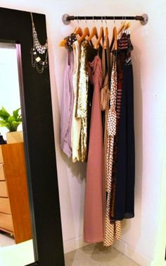 Add a staging area for getting dressed: hang a bar up in a corner or on a wall and put your outfits together for the week.,  This saves you valuable time in the morning, and gets you excited for your outfits!