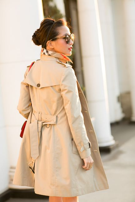 Petite trench!  The belt hits her at the waist, making this coat perfectly proportionate.