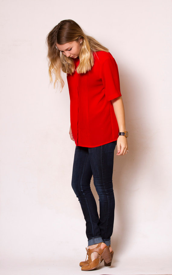 Red short sleeve blouse.