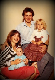 Here's a family picture just after my brother Tyler was born.  How stylish is her black and white striped sweater and red skirt, right?  I'd wear that now!